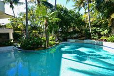 House in Key West, United States. VERY LARGE AND LUXURIOUS WATERFRONT 3 STORY MANSION WITH PRIVATE BEACH,  POOL AND SPA. NO EXPENSE WAS SPARRED - With unspoiled views from every angle, to playful colors, and unrivaled decor and design, this home is a Chateau unlike any other.  KEY...