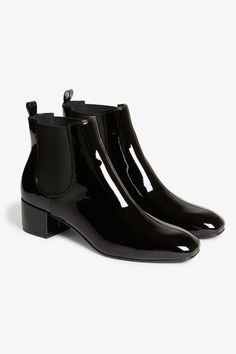 Maximus chic square-toe boots made of patent pleather with stretch panels at the ankles and a seam running down the middle. A nice heel on them too.