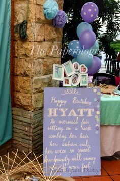 A mauve board and a family photo display all in the theme