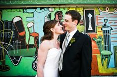 Bride & Groom portrait in front of park mural. Wedding planning by Simply Wed. www.simplywed.com