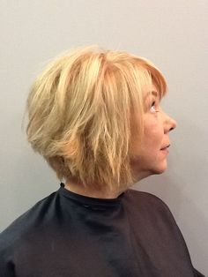 Short hair style. Blonde Hair. Copper low lights.