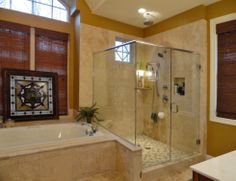 Master bath from the Birchwood Plan 1239 http://www.dongardner.com/plan_details.aspx?pid=3751 The master bathroom is a spa-like retreat with dual vanities, a large walk-in shower, built-ins and a vaulted ceiling. #MasterBath #Craftsman #House #Plan