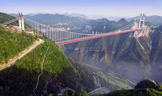 The Aizhai Bridge in Hunan Province, China is 1,102 feet high (or 1,150, as reports differ) and 3,858 feet long, making it the tallest tunnel-to-tunnel bridge in existence. Aizhai also has the longest span in the realm of super-high bridges.