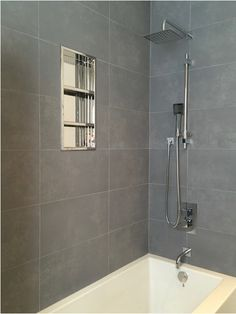 one piece shower faucet. Grey Modern Bathroom  Beautiful new very deep soaker tub Stainless steel alcove shelf cubby for shower storage Basement bathroom Porcelain wall tiles modern one piece
