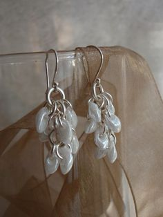 Silver Shaggy Loops Earrings with White Lustre by cutterstone, $15.00