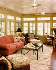 Sunroom. Love the bead board ceilings, walls and rug.
