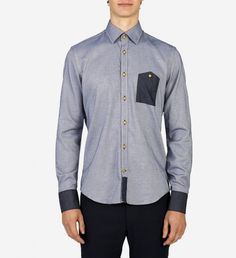 Textured Cuff Shirt by Blue Industry $140 | Centuries later, chambray's dense weave and fine cotton is still used to bring soft spoken appeal to every day shirts. Dutch cult label Blue Industry's modern cut and denim contrast cuff are distinguishing touches to the humble shirt. For a canÍt miss look, pair with slim chinos and desert boots. | GOTSTYLE.ca
