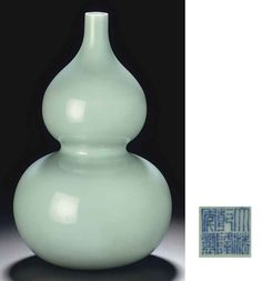 A CELADON-GLAZED DOUBLE-GOURD VASE  QIANLONG SEAL MARK IN UNDERGLAZE BLUE AND OF THE PERIOD (1735-1796)