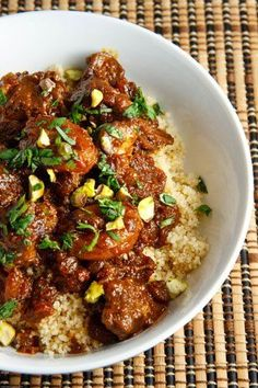 Apricot lamb tagine.  Despite the strong flavours in the sauce the taste of the lamb still came through and it really works well in this dish. Of course I served the lamb tagine on a bed of light and fluffy whole wheat couscous and I garnished it with some chopped cilantro and pistachios.