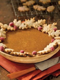 Pumpkin Pie with Autumn Leaves: The pastry oak leaves look pretty and hide crust imperfections.    #thanksgiving #recipes
