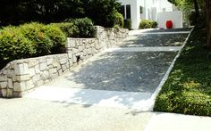 Concrete driveway with exposed aggregate surface and smooth concrete bands and border.