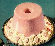 I fear that this may be a dreadful puréed salmon aspic, on top of potato salad, and festively garnished by what may be starlight peppermints. (1952)