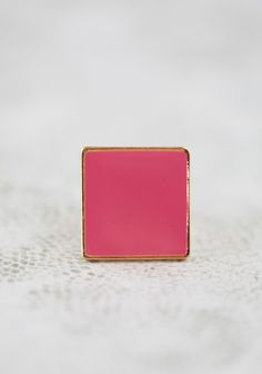 """Love Squared Ring 11.99 at shopruche.com. This gold colored ring is mod-inspired with a large square pendant with dark salmon pink enameled details.Adjustable, starting at size 6, Pendant: 1"""" long, 1"""" wide"""