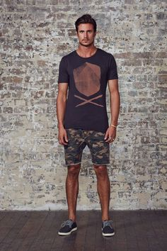 Army print Shorts styled with Black printed Tshirt