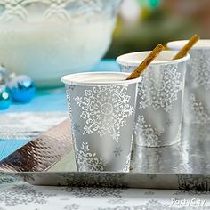 "A hammered steel tray turns snowflake-pattern cups into some kind of wonderful. We feel a round of ""Silver Bells"" coming on!"