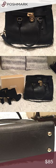 Micheal Kors Purse Professional black tote with gold lock. Excellent condition. 💯 authentic. Few marks of wear shown in the picture but I only noticed them when inspecting the bag for posting. Used a few times nearly brand new. 👜💛 Michael Kors Bags Totes