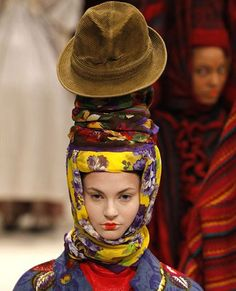 I love this hat on top of layers of fabric...Kenzo 2011