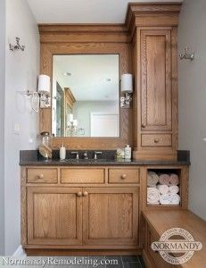 The Floor To Ceiling Vanity Adds Height And Interest E Bathroom Bench Also Storage Allows Homeowners Have Convenient Access