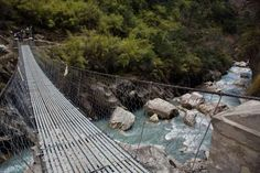 HANGING BRIDGE OF GHASA, NEPAL -- Built over the Kali Gandaki River near the town of Ghasa, this bridge was originally constructed to ease traffic congestion that was caused by animal herds on the roads.
