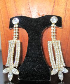 SOLD  $29.00  HUGE Vintage Runway Long DANGLING Rhinestone PIERCED Earrings-Serious Bling! by feathersoup on Etsy