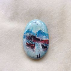 Is painted on a stone with fine art quality acrylic colors.
