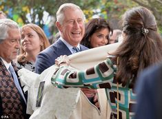 Gift: The prince is handed a poncho...