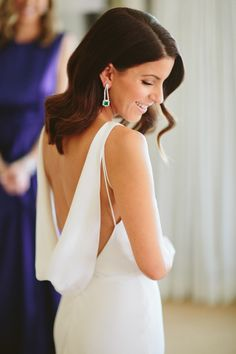 Gorgeous draped open back wedding dress: Photography : Paige Jones Photography Read More on SMP: http://www.stylemepretty.com/2016/03/02/bel-air-ballroom-wedding-with-shades-of-green/