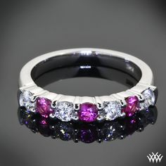 """This beautiful creation is based on our Seven Stone """"Shared-Prong"""" Diamond Wedding Band. Set in 14k White Gold, this band has been customized to hold alternating A CUT ABOVE® Hearts and Arrows Diamond Melee and Rubies (0.50ctw)."""