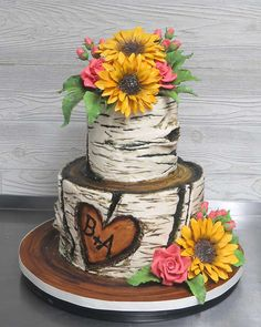 Country Wedding Cakes Birch tree bark look achieved using mostly buttercream to decorate, and then further adorned with sugar flowers: sunflowers, pink roses and buds, and pretty greenery. Fancy Wedding Cakes, Country Wedding Cakes, Wedding Cake Roses, Amazing Wedding Cakes, Wedding Cake Rustic, Wedding Cake Toppers, Sunflowers And Roses, Sugar Flowers, Pink Roses