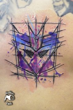 superb Optimus Prime watercolor tattoo on back