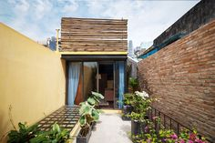This is ancient Chinese house in small alley, District 1, some steps to Ben Thanh market. We have created tropical garden on the rooftop of a restored indochine-style house. Creating the natural environment with natural brick, stone flooring, iron decoration, wood furniture, bamboo, and pottery.