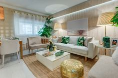 Ana Antunes | Sala de Estar | Living Room | Tropical Inspiration | White | Beige | Green | White Sofa | Palm Leaf Cushions | Wallpaper | Coffee Table Decor | Golden Moroccan Pouf | Hand-Woven Natural Rug | Modern | Home | Interior | Design