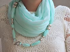Tiffany colored jewelry scarf wrapped around my neck and hooked on the front with a snap-hook that lets the scarf be used in many other different ways! The scarf is embellished with other smaller accessories and with crystals...a very unique piece!