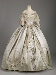 """Evening dress, Attributed to Worth & Bobergh, France: 1861, silk satin, silk ribbon, hand-made point de gaze lace. """"Although married in Chicago in 1858, it was not until 1874 that the McCormick family constructed a permanent Chicago residence. They had homes in both New York and Washington and traveled abroad extensively, particularly to European expositions at which McCormick agricultural machinery was exhibited..."""""""