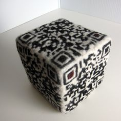 https://flic.kr/p/a8RsgT | QRandom 256 | QRandom by Shannon Henry, Polymath Design Lab  Designed for the QR-3D competition, needle felted by hand.   This handmade QR-code cube extends the idea of dice to create a sort of meta-die. Each side is patterned with a functional QR-code which directs the viewer to a page on random.org which 'rolls' from 1 to 6 6-sided dice. Each face is market with red pips in one of the QR code squares to denote how many dice will be rolled.