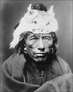 Edward S. Curtis portrait photo of a Navajo man in a Lynx cap.