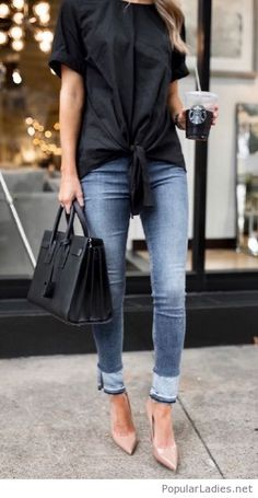 Black top and bag, jeans and nude pumps