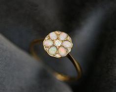 opal ring - groom's birthstone - looking for a gift for his sisters