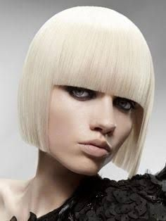 Short solid hair cut - jaw length gives strong look can be cut with or without fringe