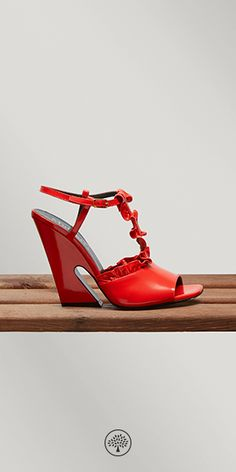 Shop the T-Bar Sandal in Coral Red Leather at Mulberry.com. Classic meets unconventional in this pair of heeled sandals with leather ruffles applied as ornamental frills. Designed with a T-Bar strap carefully following the foot's arching and a geometric block heel, this shoe has a secure fit and a sturdy feel.