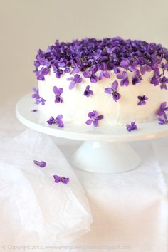 violet torte.  http://sweetvioletbride.com/wp-content/uploads/2012/05/Violet-Cake-by-Every-Cake-You-Bake.jpg  Tort fiołkowy (Violet Torte):    Genoese sponge cake:   1/3 c wheat flour (80 g)  2 T potato flour  4 eggs  1/2 c of icing sugar (100 g)  1 t vanilla sugar with real  1.5 T melted butter (20 g)  pinch of salt    Decoration/Filling:  jar of jam from the petals of violets  2 c cream, cream 30% (500 ml)  2 T granulated sugar  cup fresh or candied violets