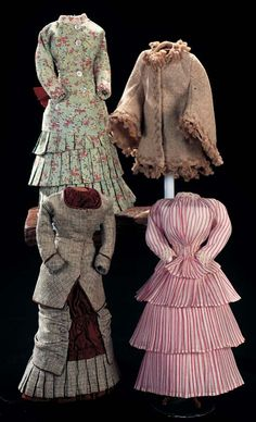 Comprising three costumes and a taupe flannel wool cape with yarn tassels. The costumes include a grey flannel two piece gown with brown silk trim; aqua cotton sateen flowered gown with three tiers of pleated skirts,bustle and maroon silk bow,and delicate rose and cream striped two-piece gown with tiered pleated skirt. Circa 1870.