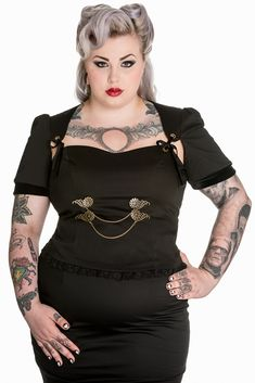Mystic Crypt Spin Doctor Plus Size Gothic Black Steampunk Lorena Top [SD6393] - Spin Doctor Plus Size Gothic Black Steampunk Lorena Top Description: • Black cotton sateen top. • Sweetheart neckline. • Seams over the bust. • Bronze coloured eyelets in the neck edge tied to a shaped panel at the shoulder with a black velvet ribbon. • Short, self fabric sleeves, gathered at the sleevehead. • Black velvet cuff. • Bronze coloured metal cogs with chains on