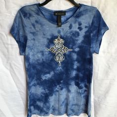 "I.N.C international concepts short sleeve t-shirt INC international concepts short sleeve t-shirt. Pretty decoration on front of shirt ( no decorations missing) it's blue tie dyed. Size L. 100% rayon. 25"" length from back collar would look cute with short or skinny jeans. Excellent condition INC International Concepts Tops Tees - Short Sleeve"