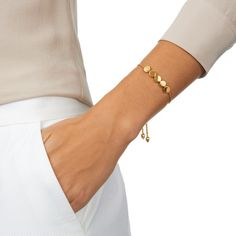 Order today with next day delivery. This sleek friendship bracelet features five flat fixed disks that rest on a double plaited rope chain, finished with beautifully sculpted ends. The disks can be engraved with...