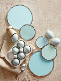 Eggshell Blue Paint Colors (from top: Arctic Blue by Glidden, The Good Life by Ace, Serene Sky by Behr, Sea Breath by Valspar, and Quench Blue by Sherwin-Williams)