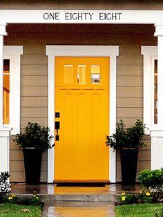Crafstman Yellow Door Design. Love this door & window moulding.