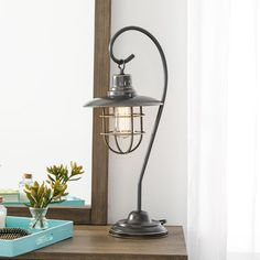 "Kind of a camping in the woods type lamp; $95;  Mercury Row Samantha 23"" H Table Lamp with Bell Shade"