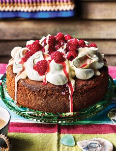 Fancy a trifle in cake form? Our raspberry and custard poke cake recipe is truly scrumptious and perfect for summer entertaining. It's called a poke cake as you poke in holes to allow the coulis to soak in. Full of fruity flavour and piled high with cream, custard and fresh raspberries, it's simply irresistible.