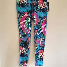 NWT Limited Edition Fila Brand new with tags, just didnt work for me! Super cute limited edition tie dye design! Performance sport running leggings. Excellent quality. Ankle length. XS. Ordered online for $60 with tax and shipping and am not able to return. Make an offer but I probably won't accept lower than $45 considering 20% commission taken out! Fila Pants Leggings